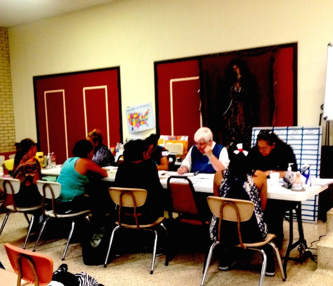 Mothers register with volunteers at the Sacred Heart shelter. (Photo: Vargas-Cooper)