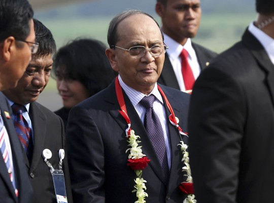 Myanmar's President Thein Sein, center, arrives at Halim Perdanakusumah airport in Jakarta, Indonesia, Tuesday, April 21, 2015 to attend Asian African Conference. (AP Photo/Tatan Syuflana)