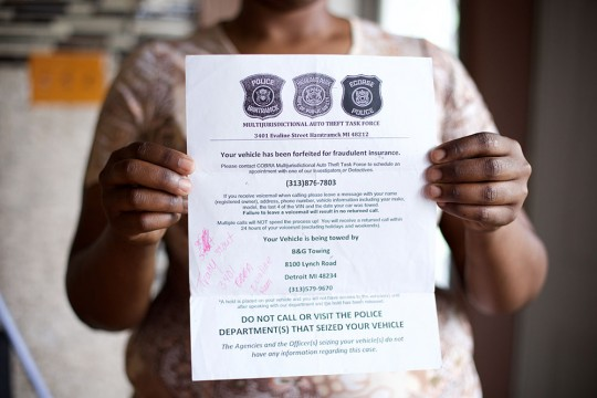 "Tracy Martin, 36, of Detroit  holding a flier by Highland Park police who had towed her truck, saying ""Multi Jurisdictional Auto Theft Task Force."" Sunday, May 17, 2015 in Detroit, Michigan."