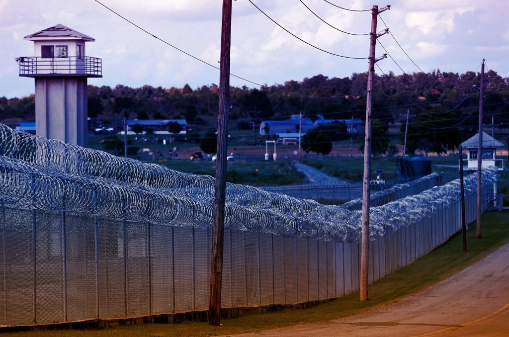 This Thursday, Oct. 9, 2014 photo shows fencing and old guard towers at the Oklahoma State Penitentiary in McAlester, Okla. (AP Photo/Sue Ogrocki)