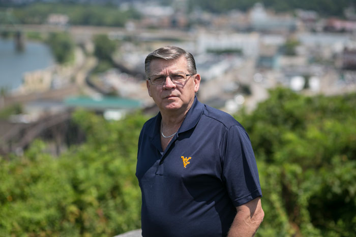 Joe Kiger stands at Fort Boreman Park in Parkersburg, WV on Wednesday, August 5, 2015.  Kiger brought a letter from Lubeck Public District, the company that provides his drinking water, to a lawyer who realized then that the entire water district had been contaminated and filed a class action lawsuit.