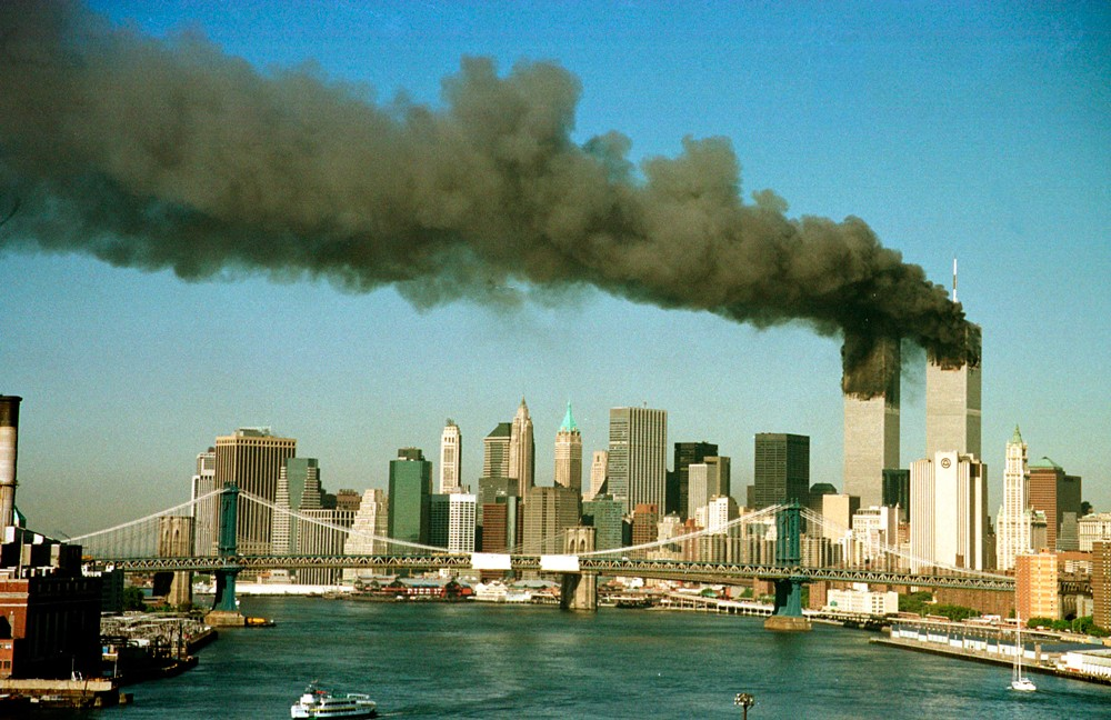 Image #: 9246    The towers of the World Trade Center pour smoke shortly after being struck by hijacked commercial airplanes in New York on September 11, 2001.  Three hijacked planes slammed into the Pentagon and New York's landmark World Trade Center on Tuesday, demolishing the two 110-story towers that symbolize U.S. financial might.  The East River and Manhattan Bridge are in the foreground.   REUTERS/Brad Rickerby /Landov