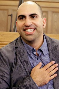 Steve Salaita, a professor who lost a job offer from the University of Illinois over dozens of profane Twitter messages that critics deemed anti-Semitic speaks to students and reporters during a news conference at the University of Illinois campus Tuesday, Sept.  9, 2014, in Champaign Ill.  (AP Photo/Seth Perlman)